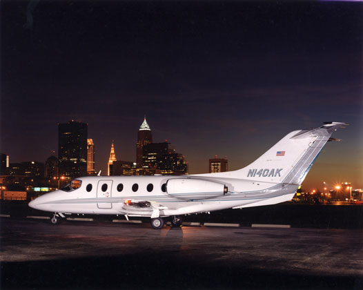 Burke Lakefront Airport · Cleveland, Ohio · Nightime shot of jet plane with Cleveland in the background for advertisement